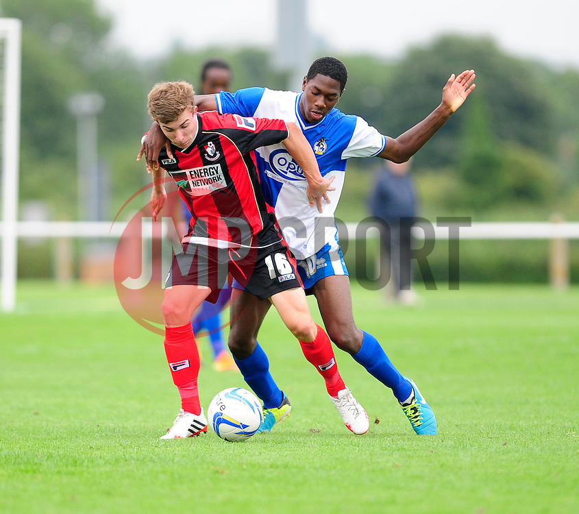 Bristol Rovers' U18s Laurent Davis-Wilson jostles for the ball - Photo mandatory by-line: Dougie Allward/JMP - Tel: Mobile: 07966 386802 17/08/2013 - SPORT - FOOTBALL - Bristol Rovers Training Ground - Friends Life Sports Ground - Bristol - Academy - Under 18s - Youth - Bristol Rovers U18s V Bournemouth U18s
