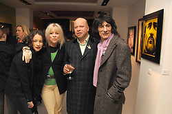 Left to right, LEAH WOOD,  JO WOOD, PAUL KARSLAKE and RONNIE WOOD at an exhibition of artist Paul Karslake's work entitled Ideas & Idols, held at Scream, 34 Bruton Street, London W1 on 21st February 2008.<br />