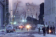 Firemen, Police and National Guard work the fire scene at the World Trade Center crash site.  9/12/01
