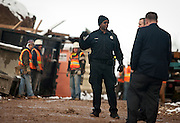 Police stand at a construction accident near the Jon M. Huntsman Center where a steel beam shifted balance and fell, injuring three workers. Two were taken immediately to the hospital and one was treated on scene, Monday, Dec. 17, 2012.