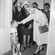 One of most popular visitors to Ireland was Her Serene Highness, Princess Grace of Monaco, formerly Grace Kelly. Here she chats with a  young patient in Our Lady's Hospital, Crumlin..12.06.1961,
