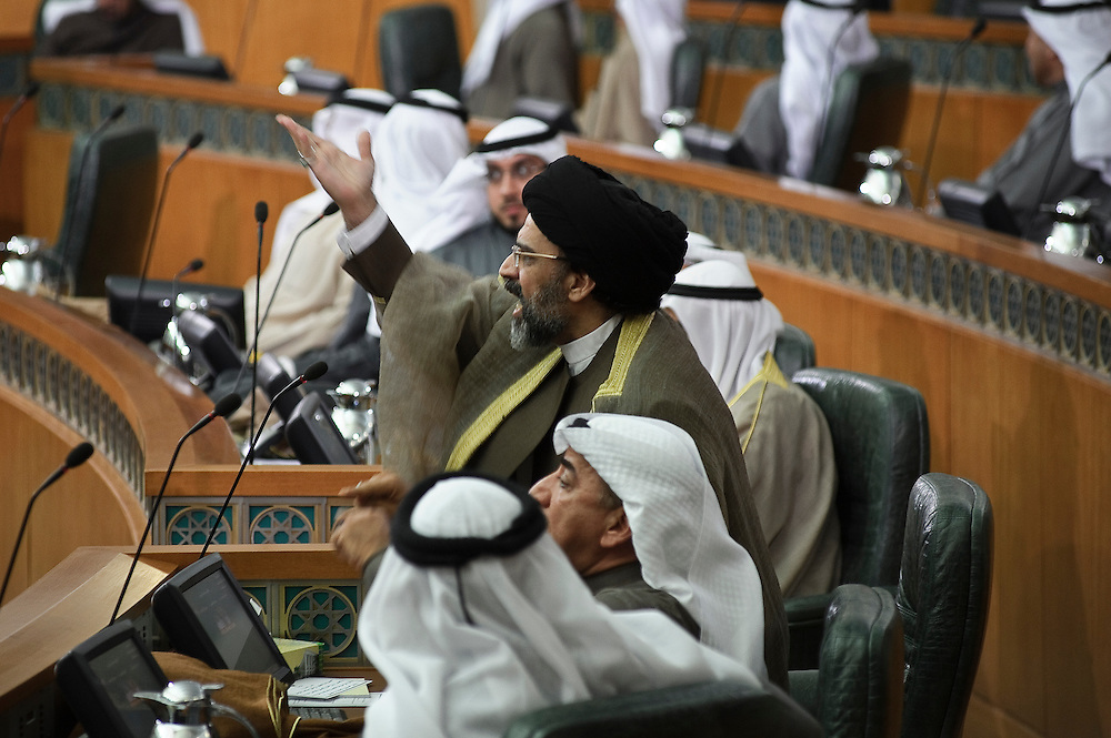 Member of Parliament Hussein Al-Qallaf gestures during a discussion in parliament following the state opening of the 14th legislative term's first session Feb. 15, 2012 in Kuwait City. Kuwaitis voted Feb. 2 for a new 50-member National Assembly (parliament).