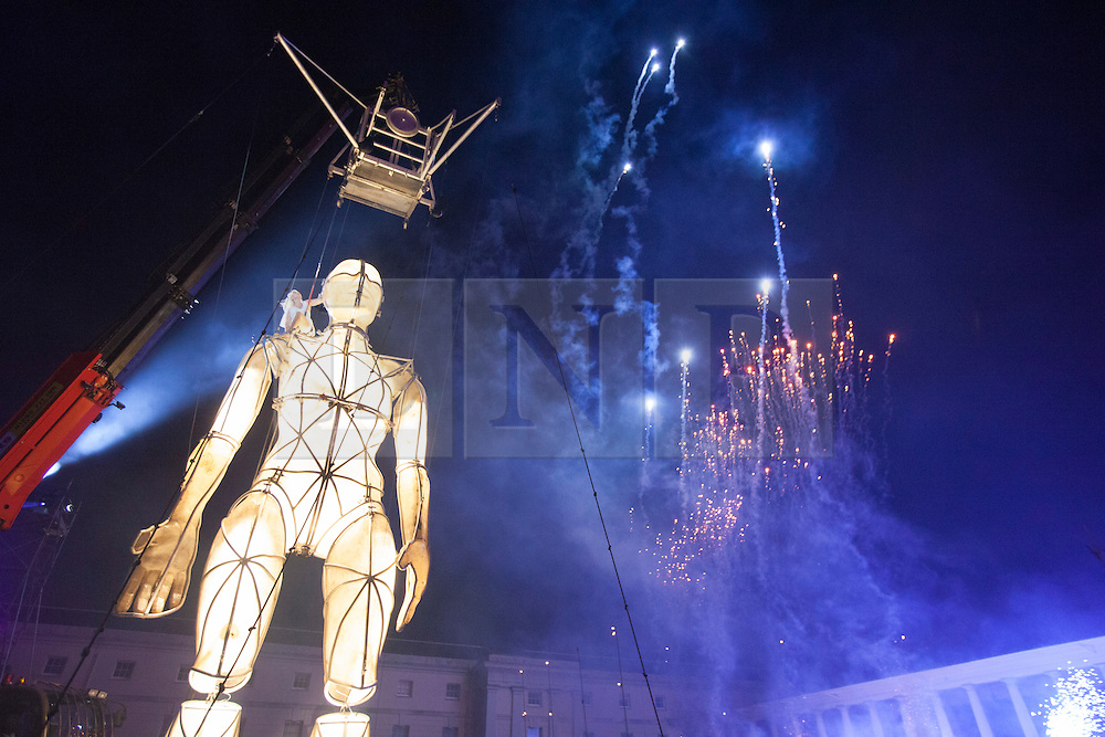 © licensed to London News Pictures. London, UK 22/06/2012. A ten-metre high Prometheus puppet arises with a theatrical event outside National Maritime Museum last night as part of the London 2012 Festival. The showcase is the first ever large-scale outdoor theatre production in the UK that is led by disabled artists. Photo credit: Tolga Akmen/LNP