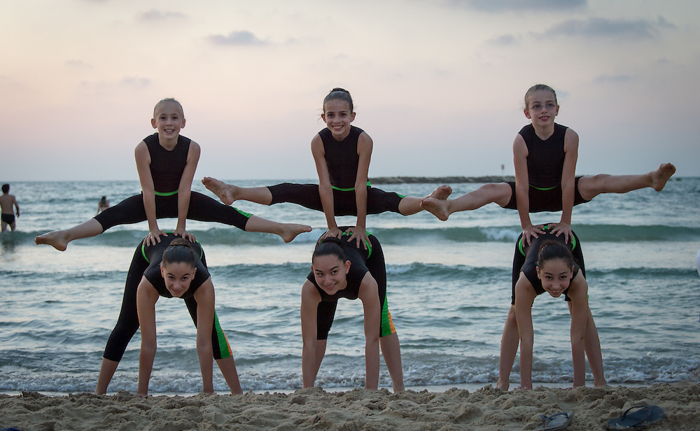 Members of the Ganei Tikva Maccabi Leader  acrobatics team on the beach in Tel Aviv