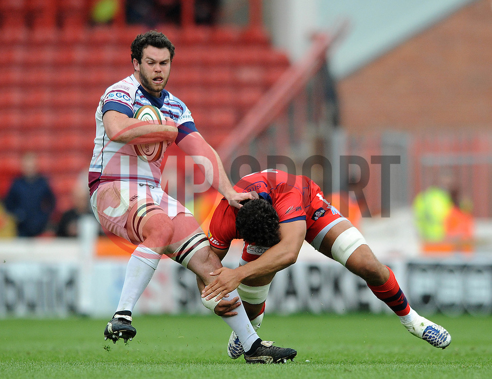 Rotherham Flanker Alex Rieder is tackled by Bristol replacement Marco Mama - Photo mandatory by-line: Dougie Allward/JMP - Mobile: 07966 386802 - 02/05/2015 - SPORT - Rugby - Bristol - Ashton Gate - Bristol Rugby v Rotherham Titans - Greene King IPA Championship