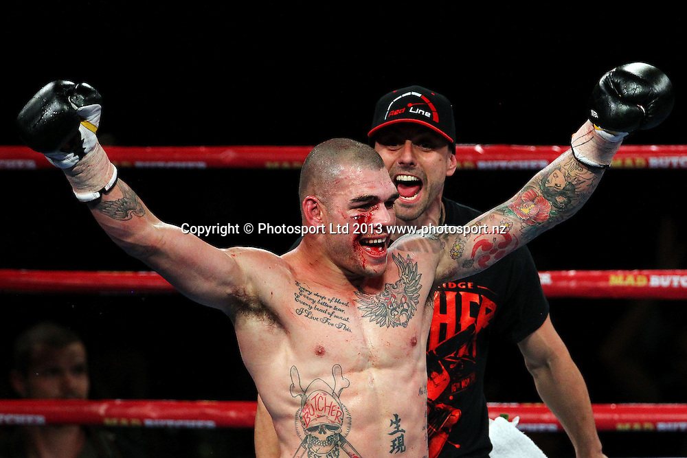 Robbie Berridge ccelebrates after winning the fight against Daniel Mackinnon. Hydr8 Zero, David v Goliath by Duco Events, Claudelands Event Centre, Hamilton, New Zealand. Saturday 16th November 2013. Mandatory Photo Credit: Anthony Au-Yeung www.photosport.co.nz