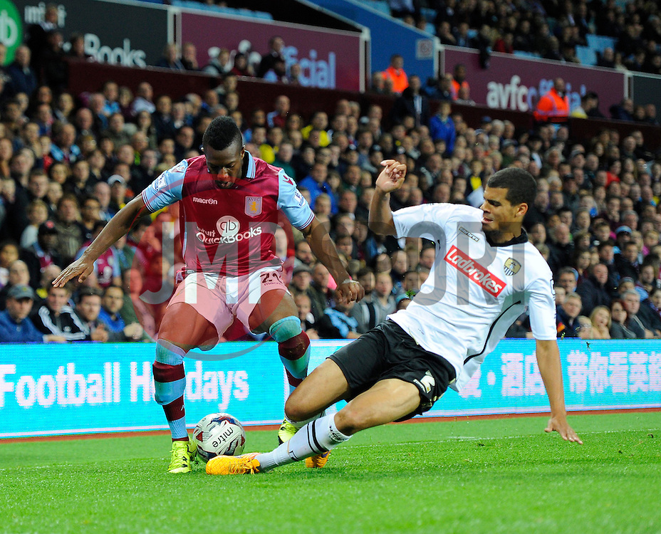 Adama Traore of Aston Villa is fouled and injured by Mawouna  Amevor of Notts County - Mandatory byline: Joe Meredith/JMP - 07966386802 - 25/08/2015 - FOOTBALL - Villa Park -Birmingham,England - Aston Villa v Notts County - Capital One Cup - Second Round