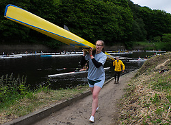 © Licensed to London News Pictures.13/06/15<br /> Durham, England<br /> <br /> A girl carries her boat after racing during the 182nd Durham Regatta rowing event held on the River Wear. The origins of the regatta date back  to commemorations marking victory at the Battle of Waterloo in 1815. This is the second oldest event of this type in the country and attracts over 2000 competitors from across the country.<br /> <br /> Photo credit : Ian Forsyth/LNP