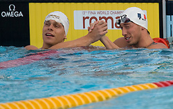 Cesar Cielo Filho of Brasil and Frederick Bousquet of France compete during Men's  50m Freestyle Semifinal during the 13th FINA World Championships Roma 2009, on July 31, 2009, at the Stadio del Nuoto,  in Foro Italico, Rome, Italy. (Photo by Vid Ponikvar / Sportida)