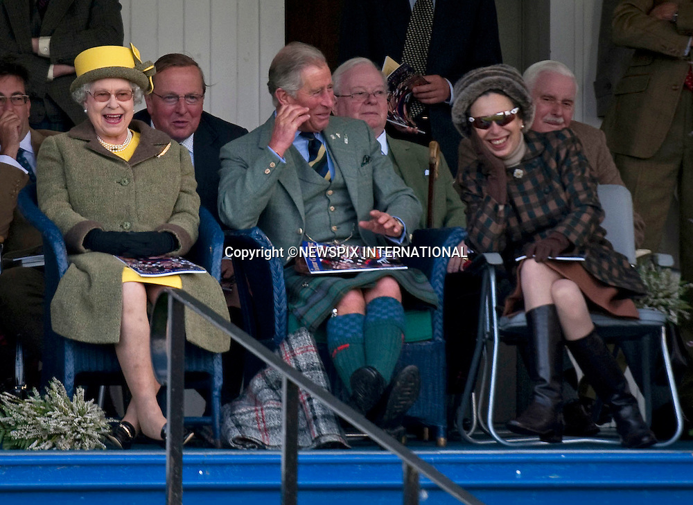 """PRINCE CHARLES - THE JOKER.The Prince kept family members who included The Queen, Prince Philip and Princess Anne entertained compensating for the rainy Braemar Gathering, Braemar, Scotland_05/09/09.Mandatory Credit Photo: ©DIAS-NEWSPIX INTERNATIONAL..Please telephone : +441279324672 for usage fees..**ALL FEES PAYABLE TO: """"NEWSPIX INTERNATIONAL""""**..IMMEDIATE CONFIRMATION OF USAGE REQUIRED:.Newspix International, 31 Chinnery Hill, Bishop's Stortford, ENGLAND CM23 3PS.Tel:+441279 324672  ; Fax: +441279656877.Mobile:  07775681153.e-mail: info@newspixinternational.co.uk"""
