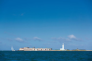 Hurst lighthouse during the Round the Island Race. Isle of Wight.<br /> Picture date: Saturday July 2, 2016.<br /> Photograph by Christopher Ison &copy;<br /> 07544044177<br /> chris@christopherison.com<br /> www.christopherison.com