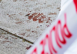 © Licensed to London News Pictures. 13/08/2019. London, UK. A bloodied hand print stains the pavement at the crime scene in Munster Square Camden where a male was stabbed to death last night. The victim, whose age has not yet been released, was pronounced dead at the scene after police were called shortly after 11pm. Photo credit: Peter Macdiarmid/LNP