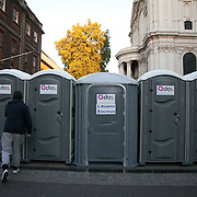Portaloos provided by the police..The London Stock Exchange was attempted occypied in solidarity with Occupy Wall in Street in New York and in protest againts the economic climate, blamed by many on the banks. Police managed to keep people away fro the Patornoster Sqaure and the Stcok Exchange and thousands of protestors stayid in St. Paul's Square, outside St Paul's Cathedral. Many camped getting ready to spend the night in the square.