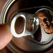 Dennis Costa poses for a photograph Wednesday, Sept. 6, 2006 at his home in the Meadow Pointe subdivision of Wesley Chapel. Costa has been collecting soda can tabs since 2000 and donates them to the Ronald McDonald House charities.