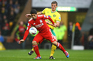 Picture by Paul Chesterton/Focus Images Ltd.  07904 640267.28/04/12.Luis Suárez of Liverpool and Ryan Bennett of Norwich in action during the Barclays Premier League match at Carrow Road Stadium, Norwich.