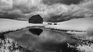 Old barn in Palouse with a pond,shot in Infrared