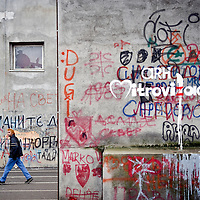 North Mitrovica, Kosovo 18 February 2011<br /> Graffiti on a wall of a school in North Mitrovica.<br /> Since the end of the Kosovo War of 1999 Mitrovica has been divided between an ethnic-Albanian-majority south and an ethnic-Serb-majority north. Its northern part is the de facto capital of the Serb enclave of North Kosovo.<br /> Photo: Ezequiel Scagnetti