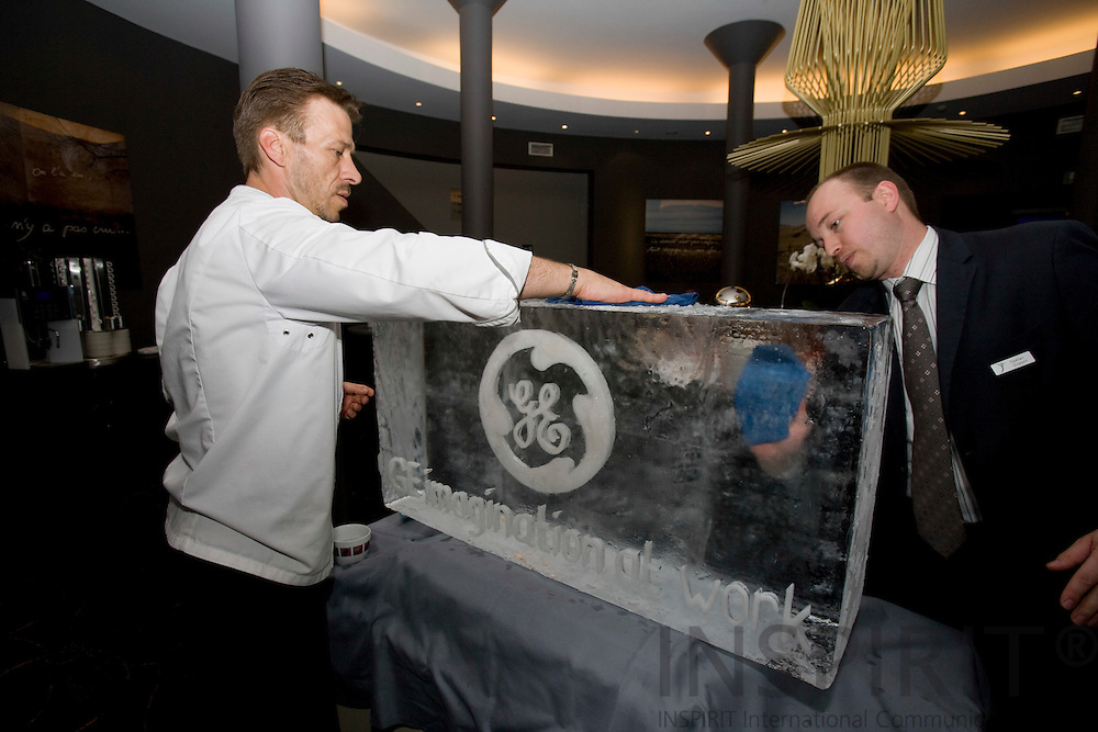 BRUSSELS - BELGIUM - 28 MAY 2008 -- Hotel staff polish a big ice cube symbolizing GEs aggressive water reduction target to free up fresh water supplies. The company pledges to reduce fresh water use by 20% by 2012.  Photo: Erik Luntang