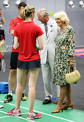 Image licensed to i-Images Picture Agency. 23/07/2014. Glasgow, United Kingdom. The Prince of Wales and Duchess of Cornwall talk to England badminton players  during a visit  to the Commonwealth Games in Glasgow  Picture by Stephen Lock / i-Images