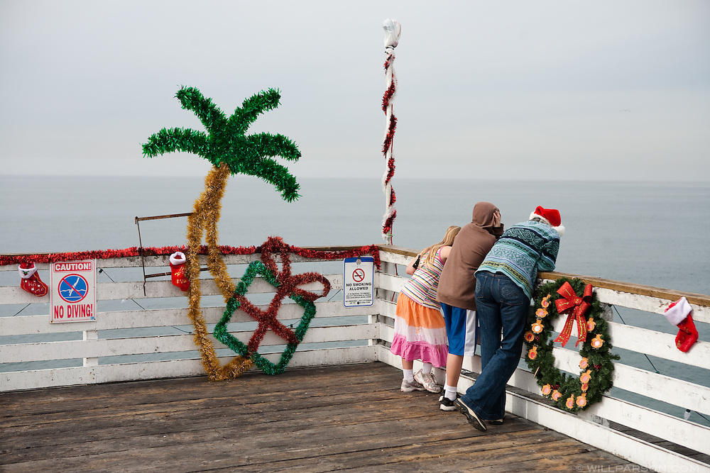 Holiday decorations line Crystal Pier in San Diego's Pacific Beach community on December 21. High temperatures in San Diego remained in the 60s over the weekend