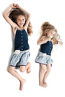 caucasian little girls full length sibling complicity isolated studio on white background