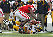 November 25, 2011: Nebraska Cornhuskers linebacker Lavonte David (4) grabs the ball as Iowa Hawkeyes tight end C.J. Fiedorowicz (86) loses it after a catch during the second half of the NCAA football game between the Iowa Hawkeyes and the Nebraska Cornhuskers at Memorial Stadium in Lincoln, Nebraska on Friday, November 25, 2011. Nebraska defeated Iowa 20-7.