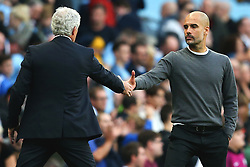 Stoke City manager Mark Hughes shakes hands with Manchester City manager Pep Guardiola at full time - Mandatory by-line: Matt McNulty/JMP - 14/10/2017 - FOOTBALL - Etihad Stadium - Manchester, England - Manchester City v Stoke City - Premier League