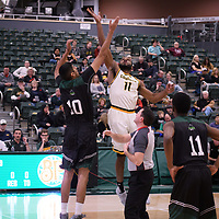 5th year forward Brian Ofori (11) of the Regina Cougars in action during the home opener on November  10 at Centre for Kinesiology, Health and Sport. Credit: Arthur Ward/Arthur Images