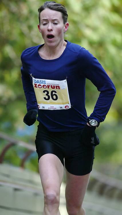 """(Toronto, Ontario -- 17 Oct 2009) MALINDI ELMORE works hard to race up the long boardwalk hill by the tiger enclosure en route to victory in the 2009 OASIS Zoo Run 10K run and Athletics Canada national 10 km road racing championship at the Toronto Zoo. [Photo credit should read """"Sean Burges / Mundo Sport Images""""]"""