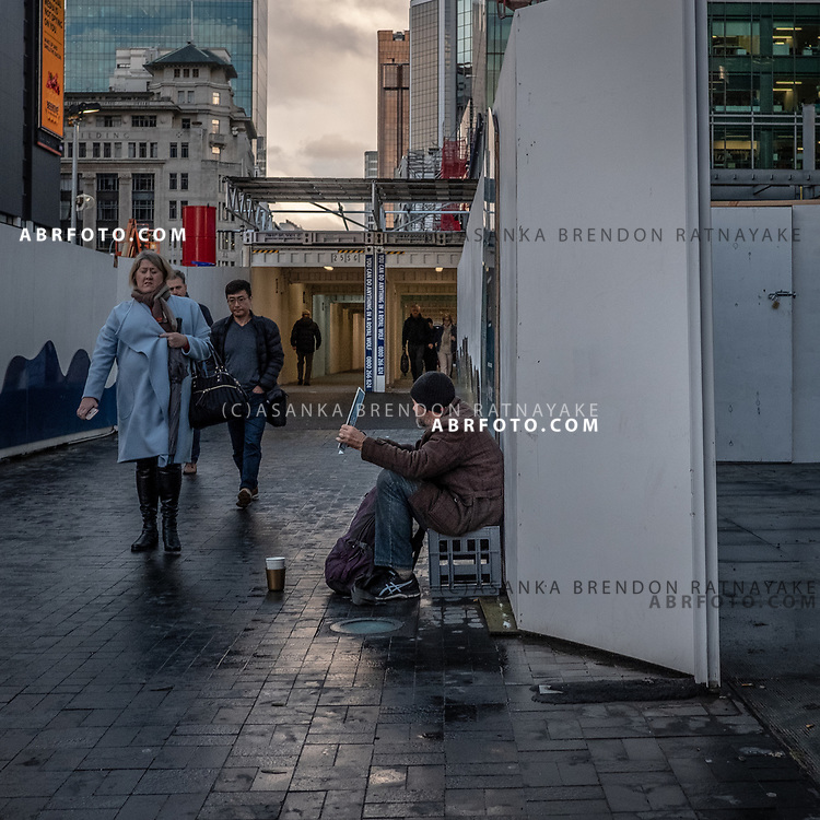 A homeless man begs in the central business district of Auckland city on the 6th of June 2018. Asanka Brendon Ratnayake for The New York Times.