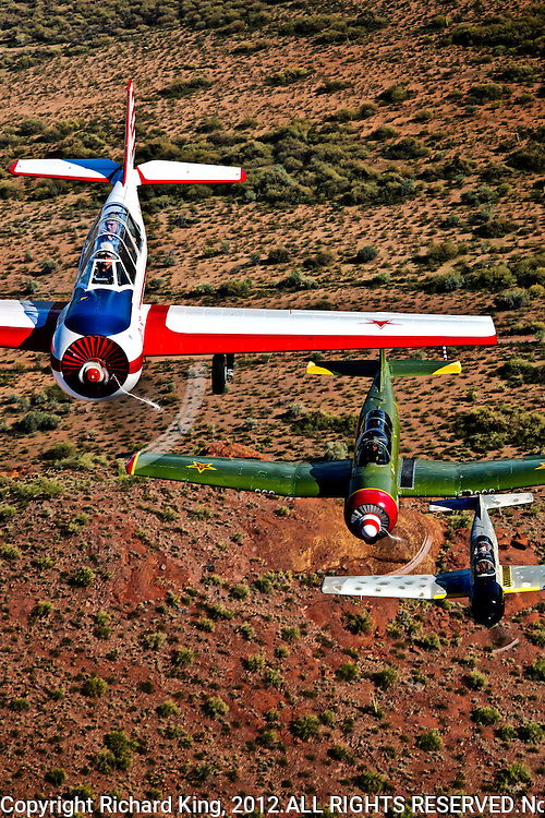 Yak-52 and Nanchangs in formation