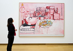 Woman looking at painting by Philip Guston; Painting,Smoking,Eating at Stedelijk Museum  in Amsterdam The Netherlands