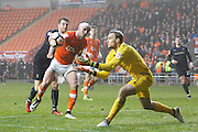 Blackpool's keeper Sam Slocombe (1) gets in first to break up Barnsley's attack during the The FA Cup 3rd round match between Blackpool and Barnsley at Bloomfield Road, Blackpool, England on 7 January 2017. Photo by Craig Galloway.