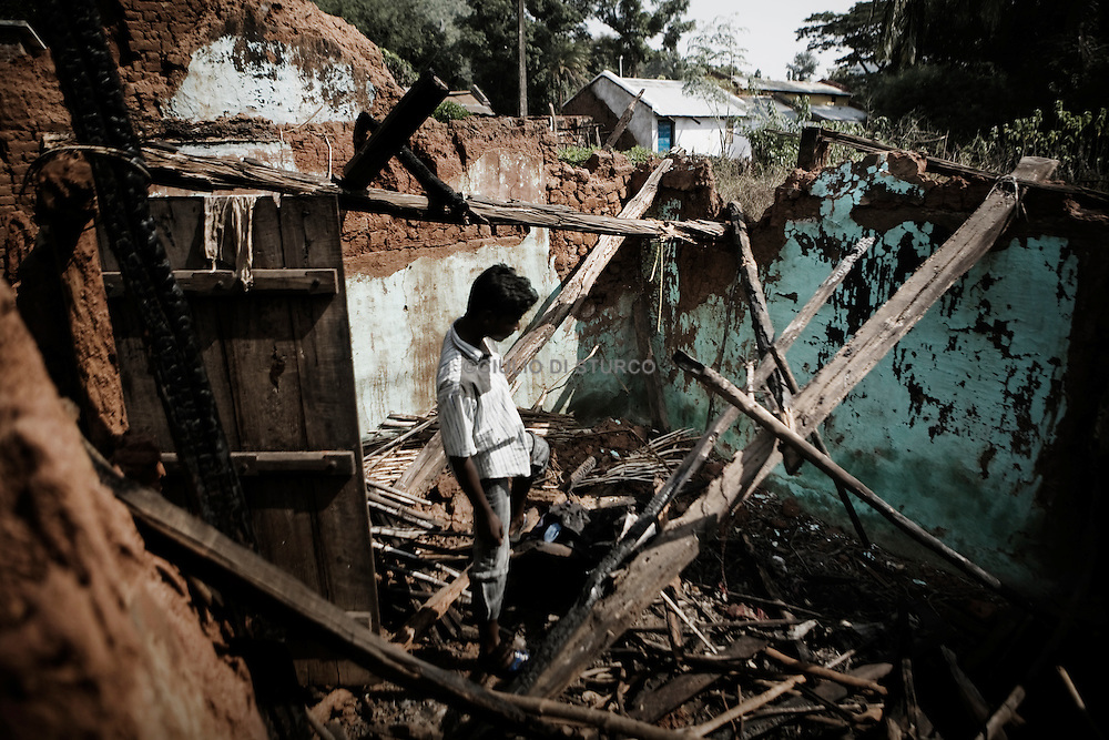 Indian Christian man returns to his house damaged during rioting by hardline Hindu activists in Orissa's Kandhamal district, some 350 kms southwest of Bhubaneswar. Nov. 6, 2008. .