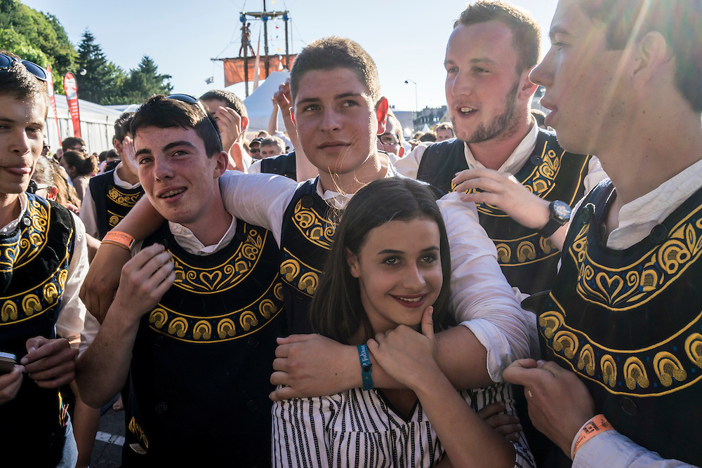 Members of Bagad Kombrid from Quimper celebrate their successful first day of competition at the Festival de Cornouaille on Saturday, July 23, 2016 in Quimper, France.