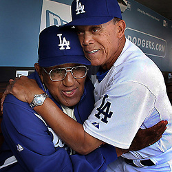 Dodger greats Don Newcombe ,Left, gets a big hug from Maury Wills during Opening day festivities before a baseball game between the San Francisco Giants and Los Angeles Dodgers March 31. 2008 at Dodger Stadium in Los Angeles.