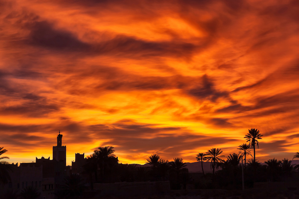 Sunrise with mosque and date palms in Ouarzazate, Morocco.