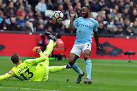 Football - 2017 / 2018 Premier League - West Ham United vs. Manchester City<br /> <br /> Raheem Sterling of Man City is foiled by goalkeeper Adrian, at the London Stadium.<br /> <br /> COLORSPORT/ANDREW COWIE