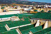 Al-Kairouine Mosque and University, Fez Medina, Morocco, 2018-02-03.<br /> <br /> Established at the very beginnings of Morocco's oldest imperial city, the University of Al-Karaouine (also written as Al-Quaraouiyine and Al-Qarawiyyin) was founded in 859 and is considered by Unesco and the Guinness Book of World Records to be the oldest continually operating university in the world.<br /> <br /> Located in the heart of the old city, the complex is composed of a mosque, university and library, and is connected to the labyrinth of interconnecting streets and alleyways on all four sides. Its ceramic green tiled roofs take centre stage over Fez's urban sprawl from any viewpoint over the city.