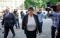 © Licensed to London News Pictures. 04/07/2017. London, UK. MARRION LITTLE (centre) arrives at Westminster Magistrates Court in London where she faces charges relating to the 2015 general election expenses of Conservative MP Craig Mackinlay. Craig Mackinlay, Nathan Gray and Marion Little have each been charged with offences under the Representation of the People Act 1983. Photo credit: Ben Cawthra/LNP