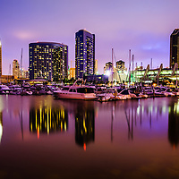 Photo of San Diego Embarcadero Marina at night with luxury yachts and downtown San Diego buildings. Image is high resolution and was taken in 2012.