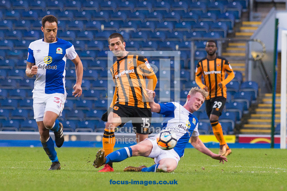 Evandro Goebel of Hull City is tackled by Willem Tomlinson of Blackburn Rovers during the FA Cup match at Ewood Park, Blackburn<br /> Picture by Matt Wilkinson/Focus Images Ltd 07814 960751<br /> 06/01/2018