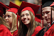 A new graduate looks around for family and friends in the audience during the Franklin High School graduation exercise at the Nutter Center in Fairborn, Saturday, May 26, 2012.