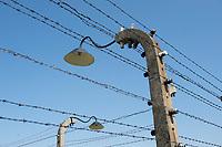 09 APR 2012, KRAKOW/POLAND:<br /> Stacheldrahtzaun und Lampen, Staatliches polnisches Museum / Gedenkstaette des ehem. Konzentrationslager Ausschitz-Birkenau<br /> IMAGE: 20120409-01-015<br /> KEYWORDS: Krakau, KZ, Vernichtungslager Auschwitz II–Birkenau, Polen