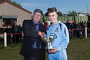 24/05/2017 - Grove Academy captain Jake Stewart is presented with the U16 Robert Caira Memorial Trophy by Dundee Schools FA Secretary Grenville Dawson - U16 Robert Caira Memorial Trophy Final  (sponsored by DSA)<br /> Morgan (light blue) v. Grove (yellow) at Whitton Park, Picture by David Young -