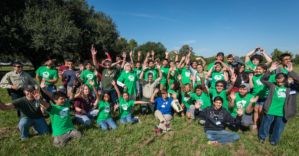 Members of the Furr High School Green Ambassadors are congratulated for being named the 2015 Diversity, Inclusion, and Outreach awardee for the Abraham Lincoln Honor Awards, the highest level of United States Department of Agriculture recognition, by US Forest Service supervisor Mark Van Every during an event at Clinton Park, October 3, 2015.