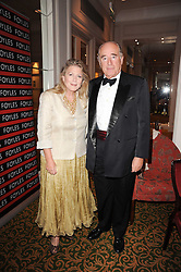 CHRISTOPHER FOYLE and his wife CATHERINE at a gala dinner in celebration of 80 years since the first Foyles Literary Luncheon, held in The Ball Room, Grosvenor House Hotel, Park Lane, London on 21st October 2010.