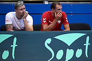 Sopot, Poland - 2018 April 08: (L) Mateusz Kowalczyk and (R) Lukasz Kubot both from Poland watch the game while Men's Single Match Nr 4 during Poland v Zimbabwe Tie Group 2, Europe/Africa Second Round of Davis Cup by BNP Paribas at 100 years of Sopot Hall on April 08, 2018 in Sopot, Poland.<br /> <br /> Mandatory credit:<br /> Photo by © Adam Nurkiewicz / Mediasport<br /> <br /> Adam Nurkiewicz declares that he has no rights to the image of people at the photographs of his authorship.<br /> <br /> Picture also available in RAW (NEF) or TIFF format on special request.<br /> <br /> Any editorial, commercial or promotional use requires written permission from the author of image.