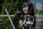 A cosplayer poses for a photograph during the Comic Market 90 (Comiket) event in Tokyo Big Sight on August 14, 2016, Tokyo, Japan. Many manga and anime fans wearing cosplay lined up in the sun for the third day of Comiket. Comiket was established in 1975 and focuses on manga, anime, gaming and cosplay. Organizers expect more than 500,000 visitors to attend this year's summer event which runs for three days until August 14.. 14/08/2016-Tokyo, JAPAN