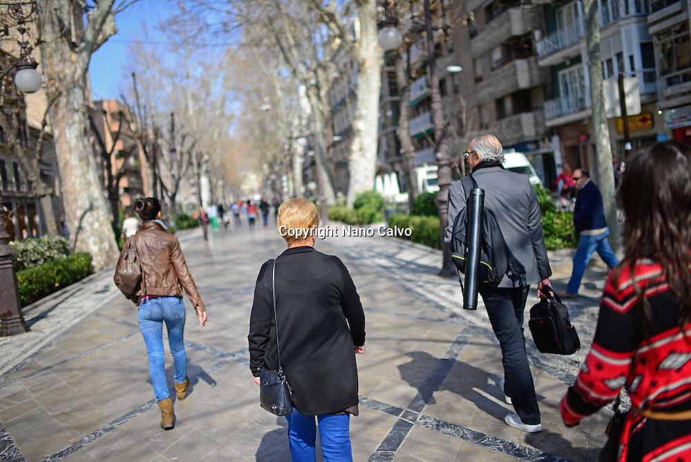 People walking the streets of Granada, Spain